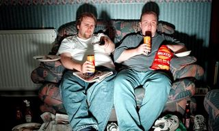 Men-lounge-on-sofa-watchi-008